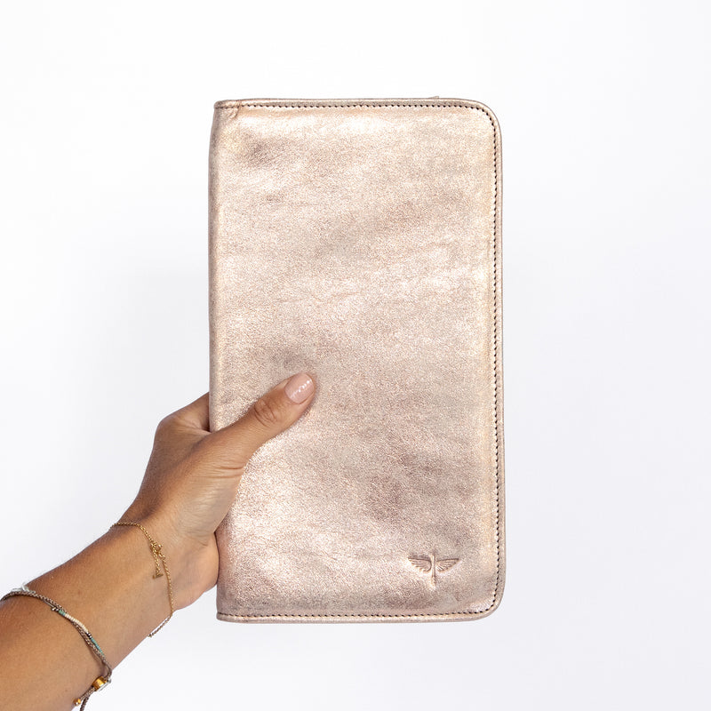 Travel Wallet in Rose Gold in Hand