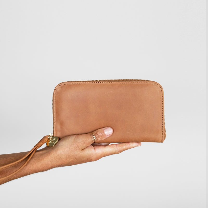 Zip Wallet in Aged tan leather in hand