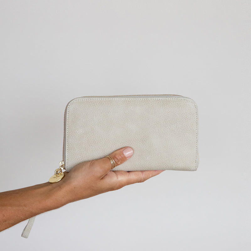 Zip Wallet in Latte leather in hand