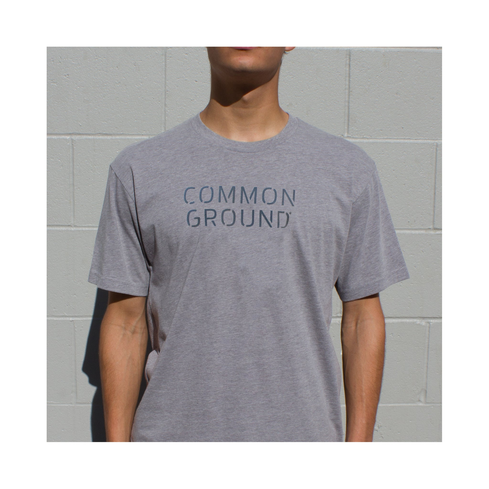Dark_Heather_Gray - Common Ground T shirt Front on Model