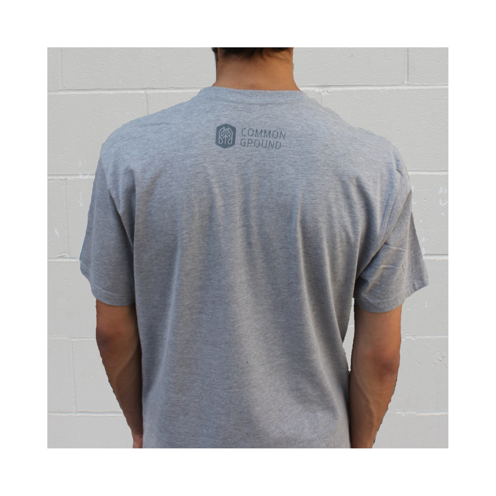 Dark_Heather_Gray - Common Ground Badge T shirt Back on Model