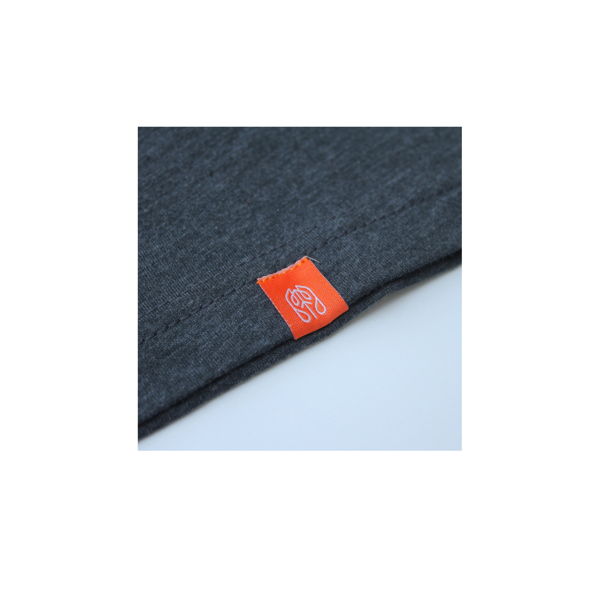 Charcoal - Common Ground T shirt Hem Tag View