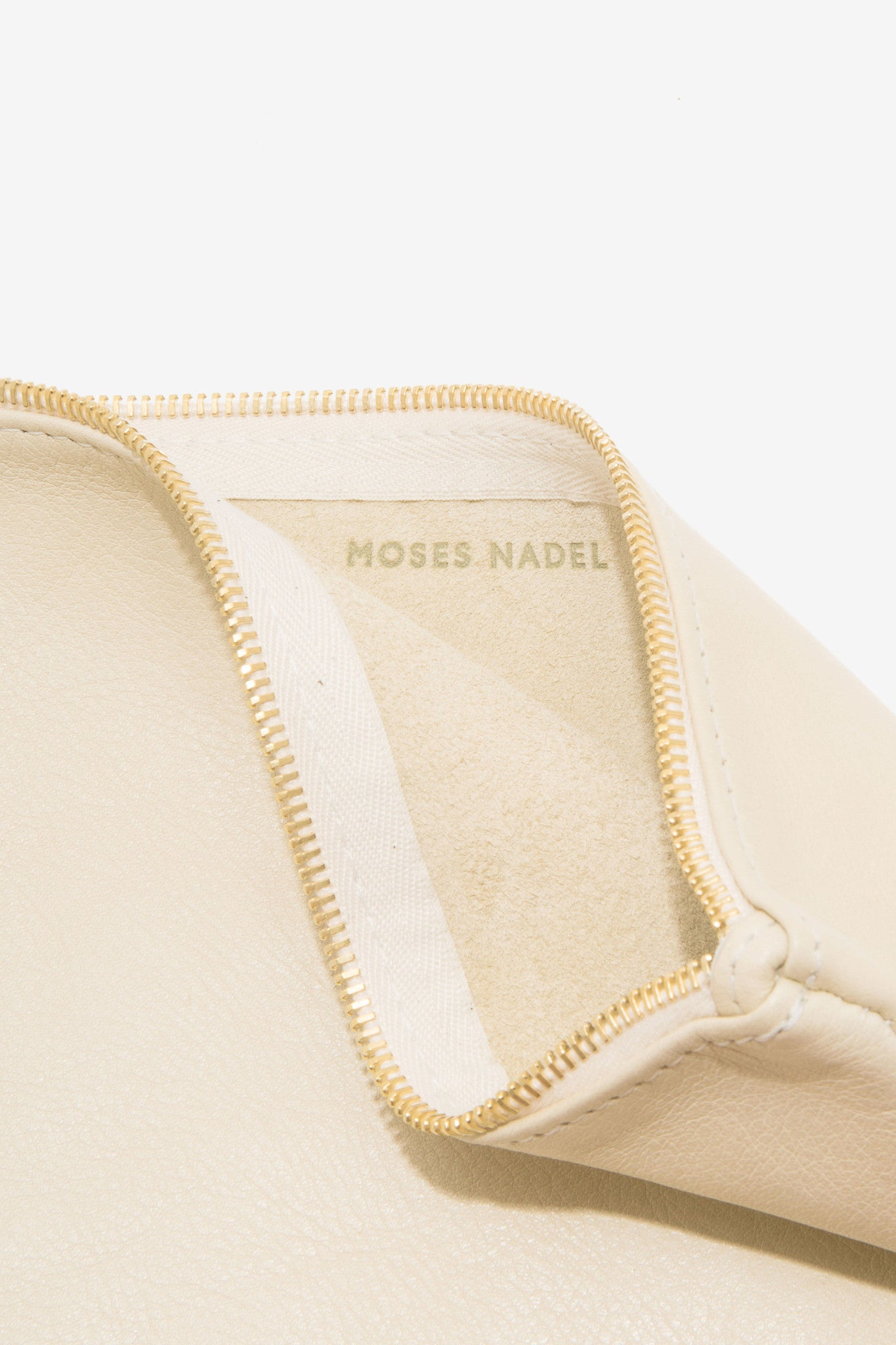 The Large Cream Pouch is a large leather pouch with a leather tassel zip by Moses Nadel.