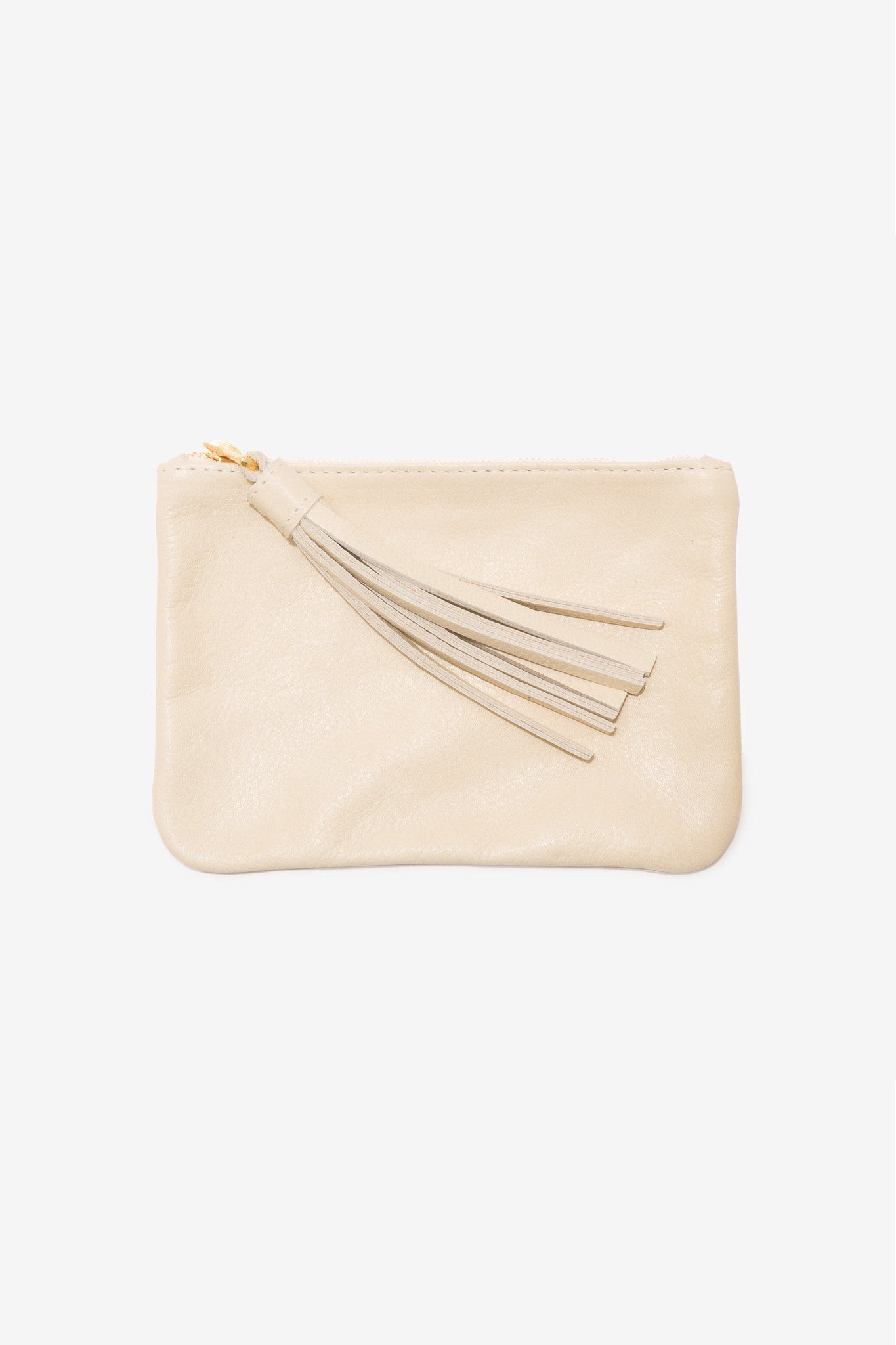 The Medium Cream Pouch is a medium leather pouch with a leather tassel zip by Moses Nadel.