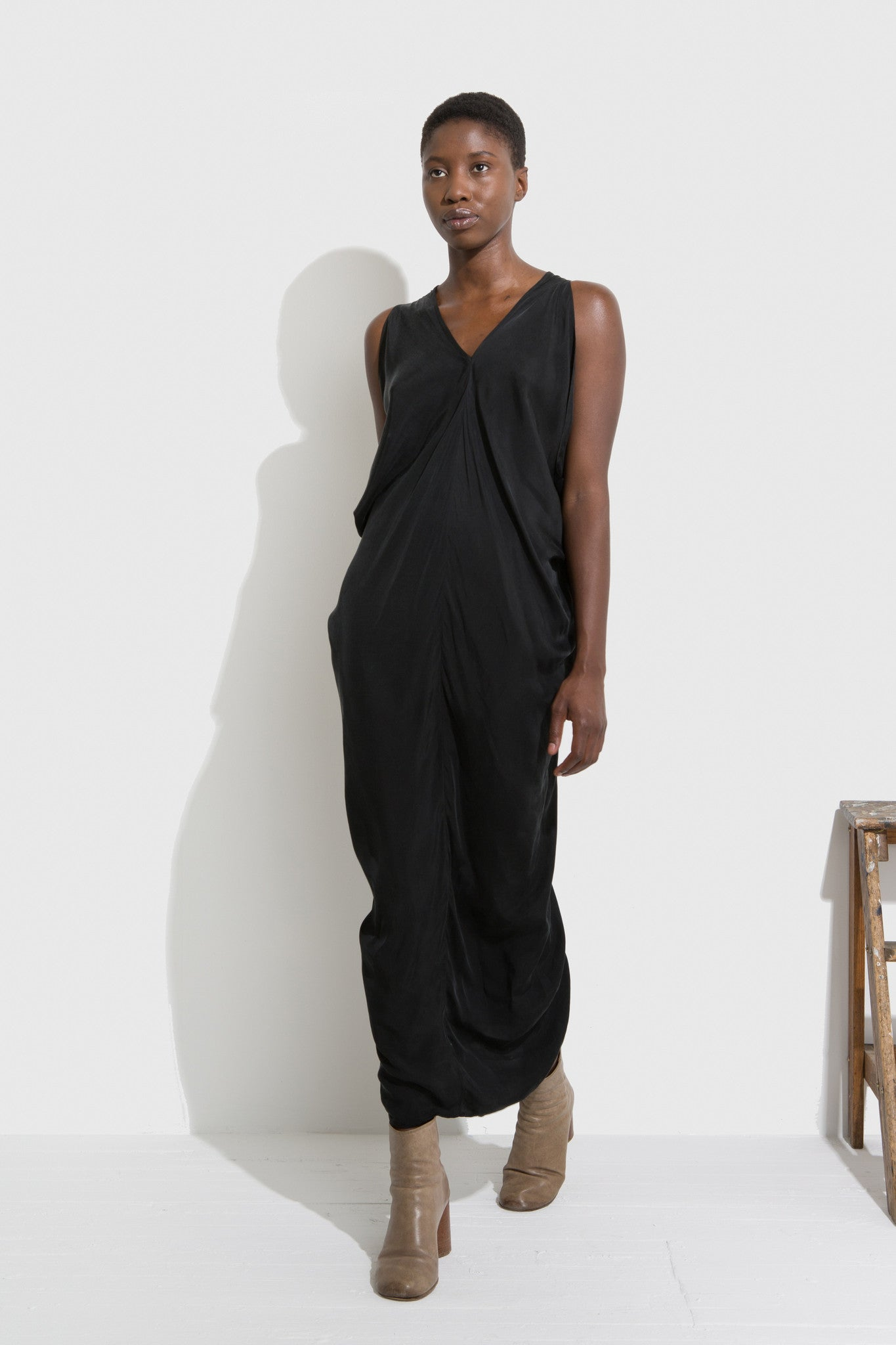 Stina Dress is a full dress with V-neck necklines in the front and back, designed by H. Fredriksson.