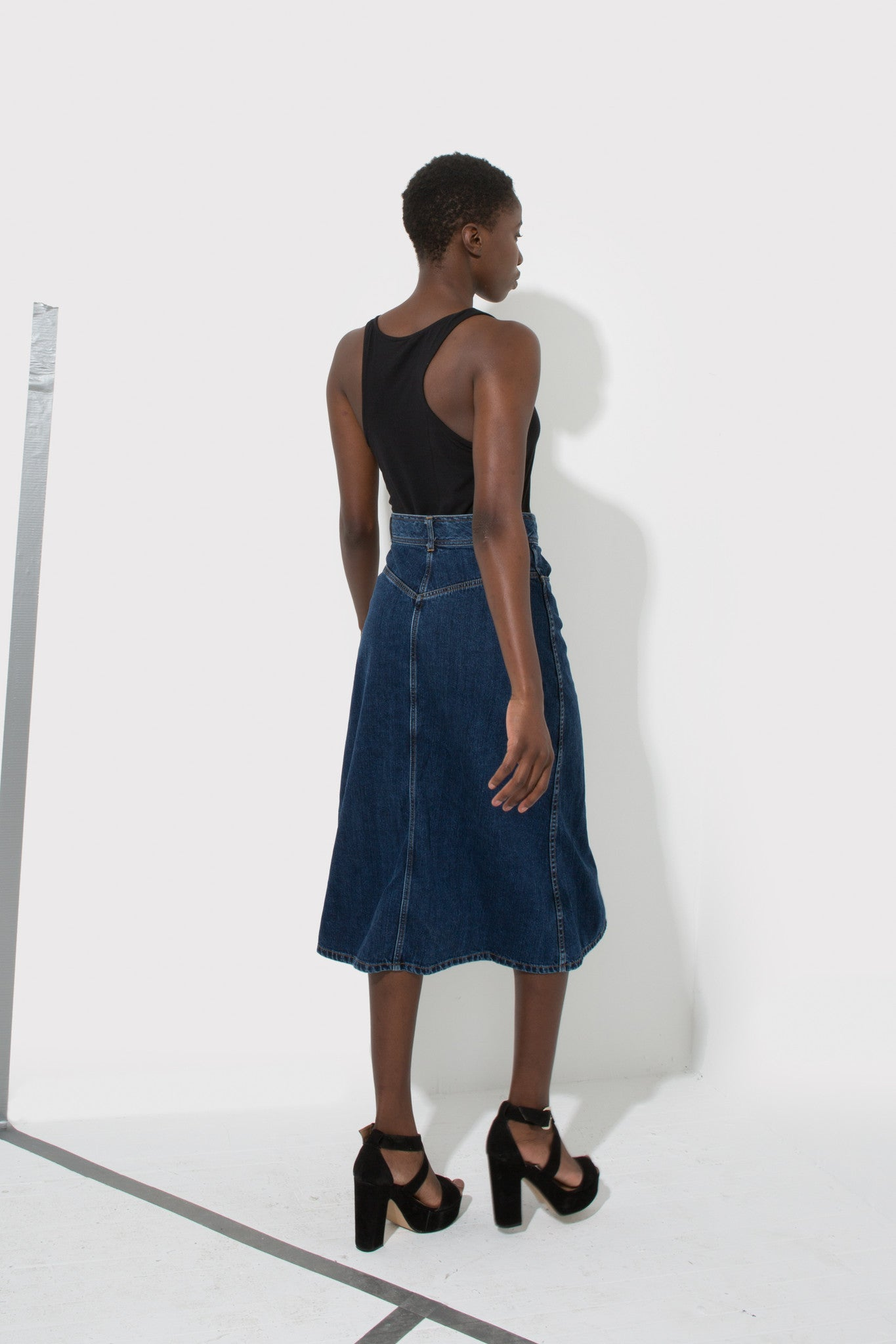 Candice front button skirt is a long, a-line, denim skirt designed by Enda