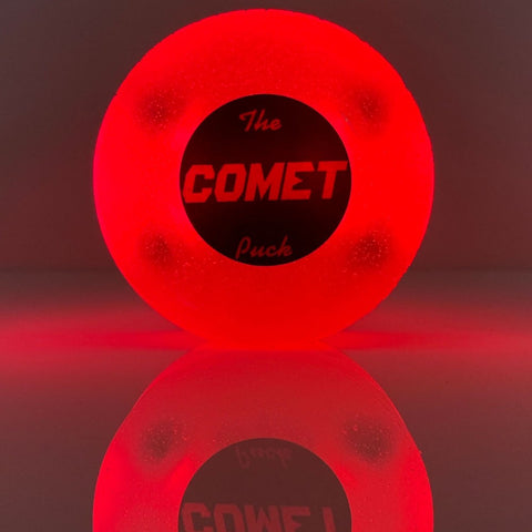 comet-puck-glow-in-the-dark-puck-for-ice-hockey