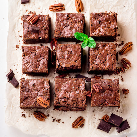 Nine brownies with nuts.