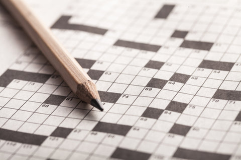 A crossword puzzle and pencil.