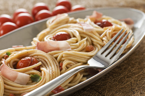 Spaghetti with prosciutto and tomatoes.