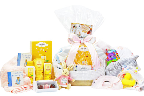 Luxury new baby girl gift basket with essential products including baby hooded towel, baby blanket, Peter Rabbit, Bath-time products and chocolate treats for Mum. Delivered NZ wide by Batenburgs Gift Hampers.