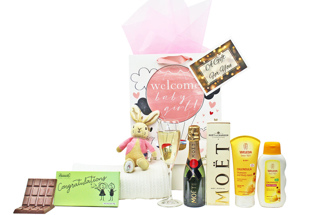 Congratulations new baby girls gift with Champagne, chocolate, organic blanket, Flopsy bunny and Weleda baby skin care.