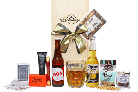 Favourite gift for men with beer, nuts, chocolate, brownie, playing cards and grooming products from Triumph & Disaster delivered NZ wide. Batenburgs Gift Hampers