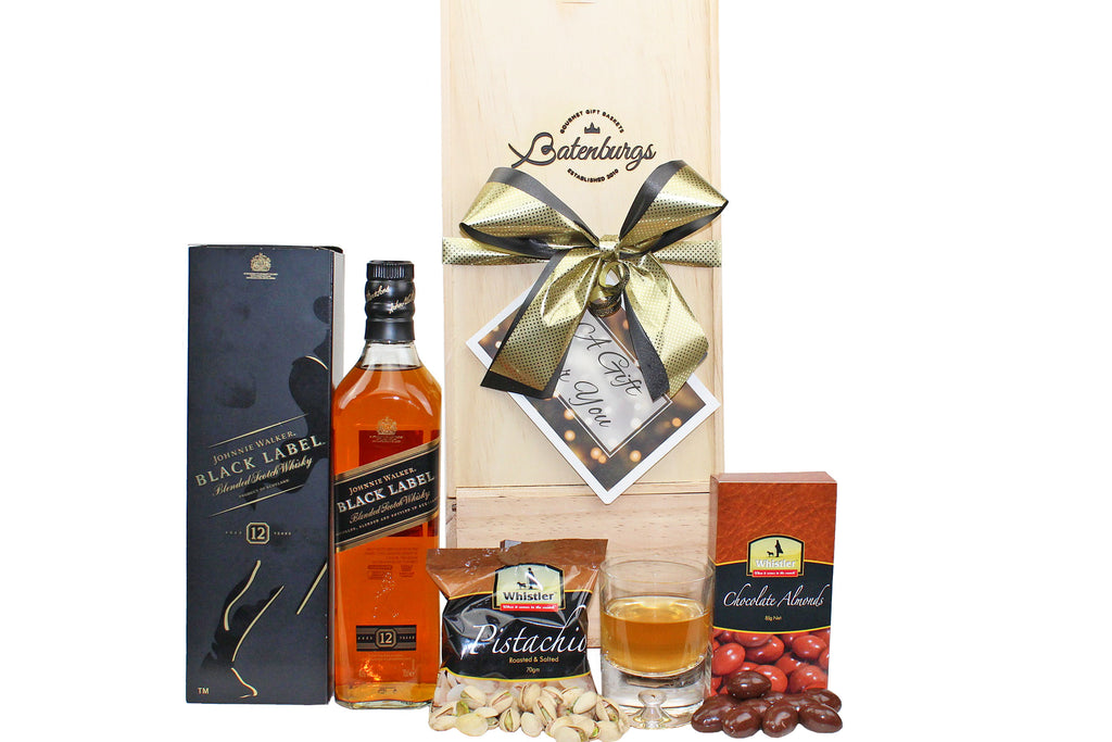 Gift box for men with Johnnie Walker whisky, chocolate almonds and pistachio nuts delivered NZ wide. Batenburgs Gift hampers