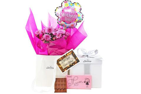 NZ Mother's Day gift combination with flowers, chocolate and balloon gift boxed.