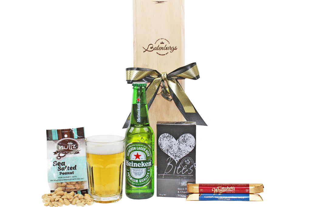 Beer and snacks gift box with heineken, nuts, savoury bites and Whittakers chocolate bars delivered NZ wide. Batenburgs Gift Hampers