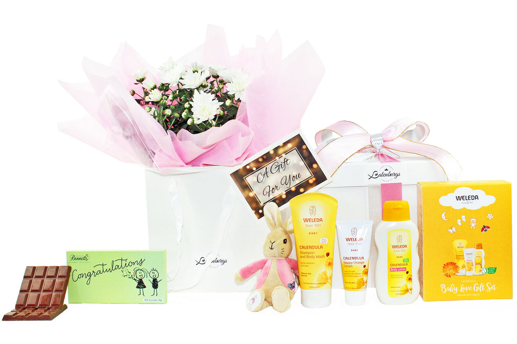 Welcome new baby girl gift box with flowers, Weleda baby skin care, Flopsy bunny and chocolate.
