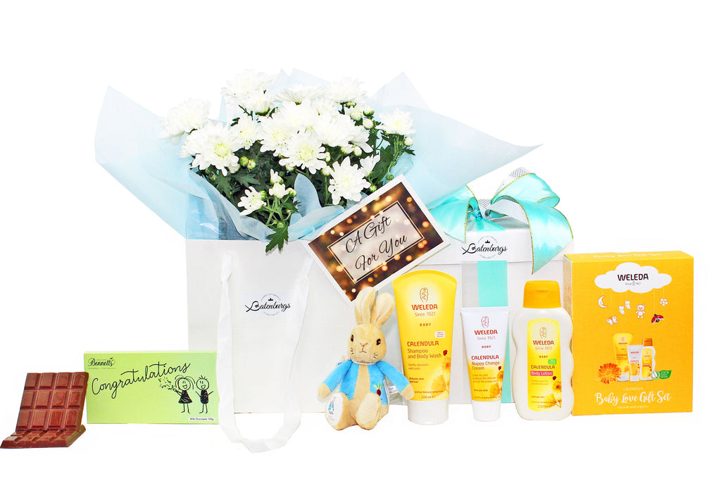 Welcome baby boy gift with flowers, Weleda baby skin care, first Peter rabbit and chocolate.