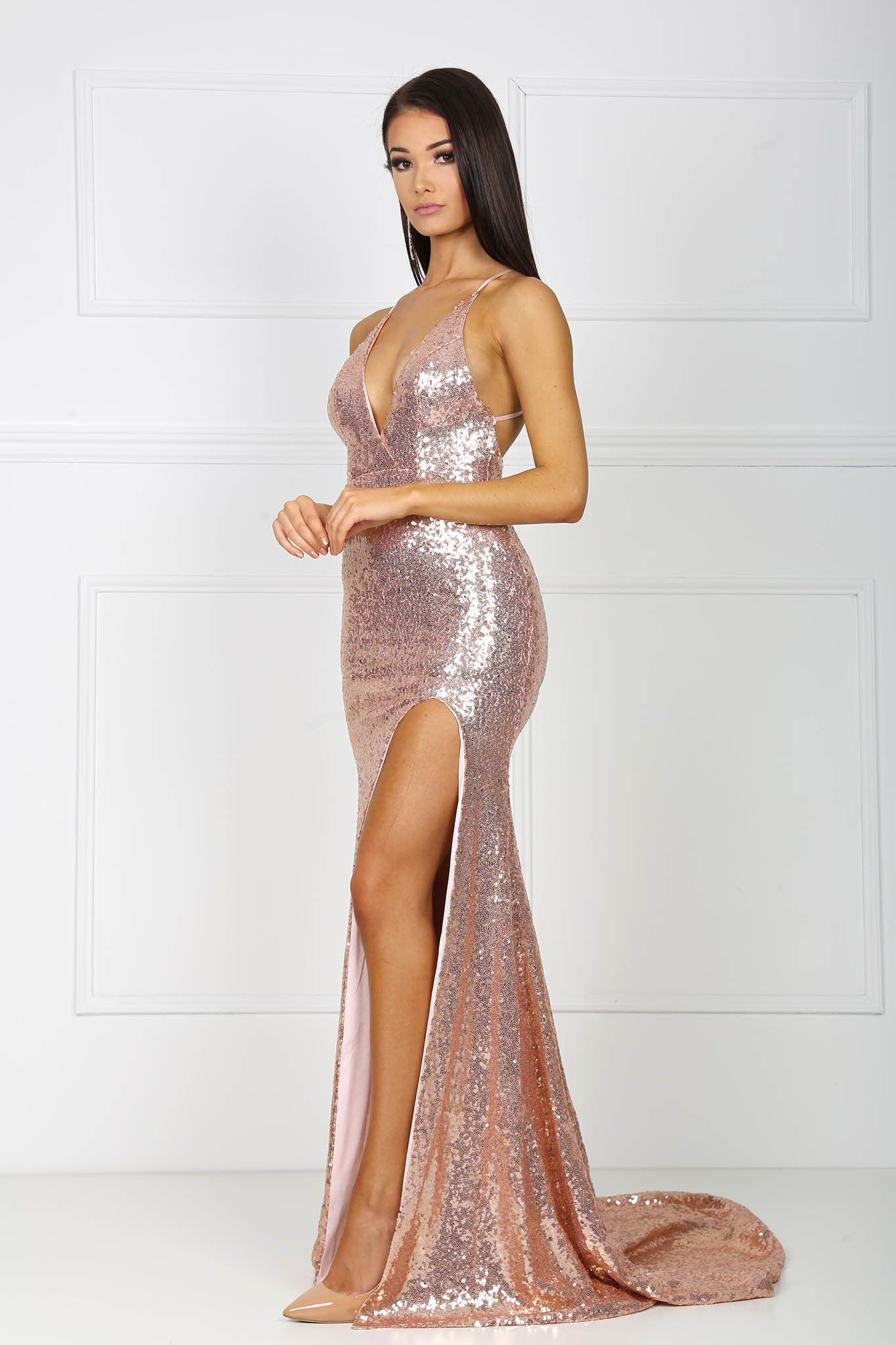 Rose gold sequin formal floor length sleeveless gown with front high split, V neckline, crisscross back thin straps, and a long train