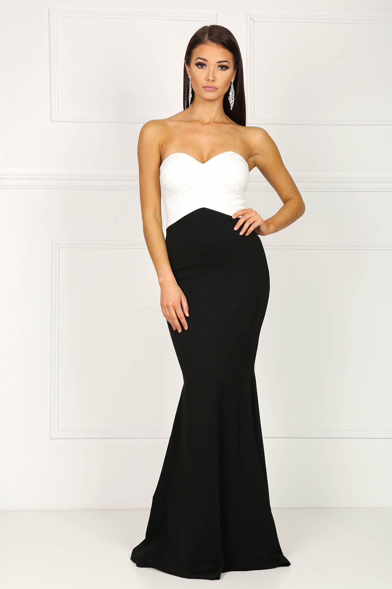 Colour block sleeveless evening floor-length gown in white at the upper body and black from the waist down with faux pearl bead details, sweetheart neckline and fishtail skirt