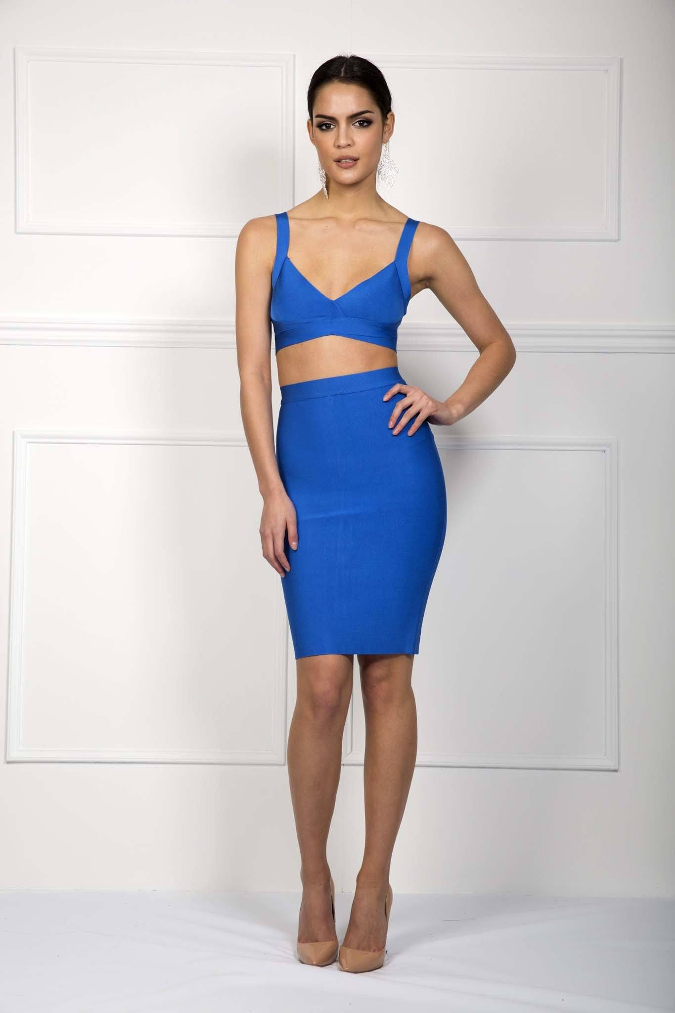 Front of blue two piece bandage set including a bralette style top and a midi pencil skirt