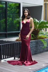 Burgundy fitted stretch satin gown with deep V neckline, ruched V open back, fit & flare long train
