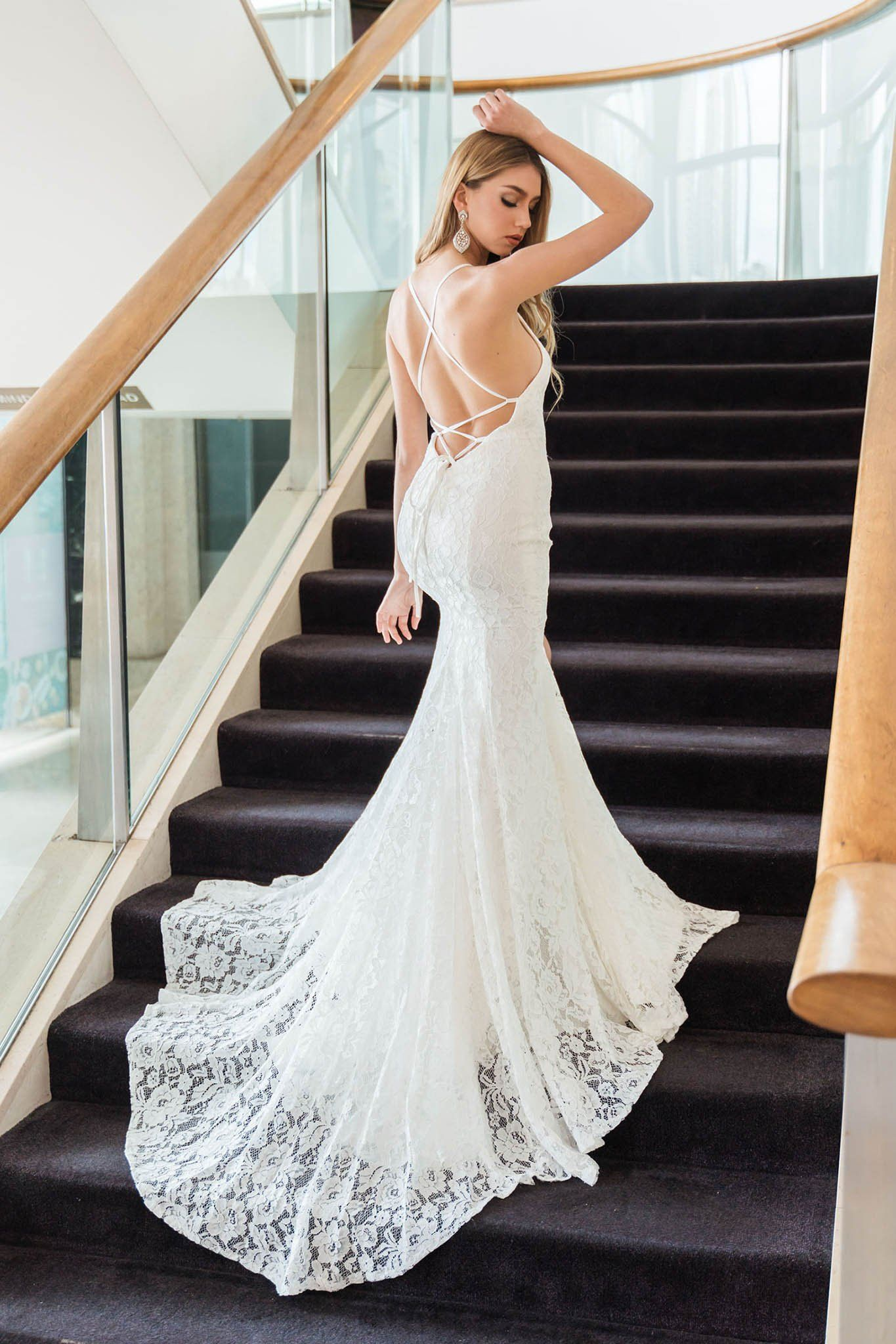 White lace mermaid long evening gown with leg split, lace up back, and long train