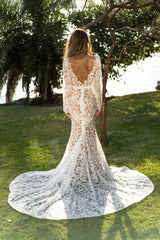 Long Sleeve Wedding Gown featuring White Vintage Inspired Lace Pattern with Chai Coloured Underlay in Sheer Illusion Design, Long Sleeves with Scalloped Edge, Fit and Flare Silhouette, Illusion V Plunging Neckline, Low Back and Sweep Train