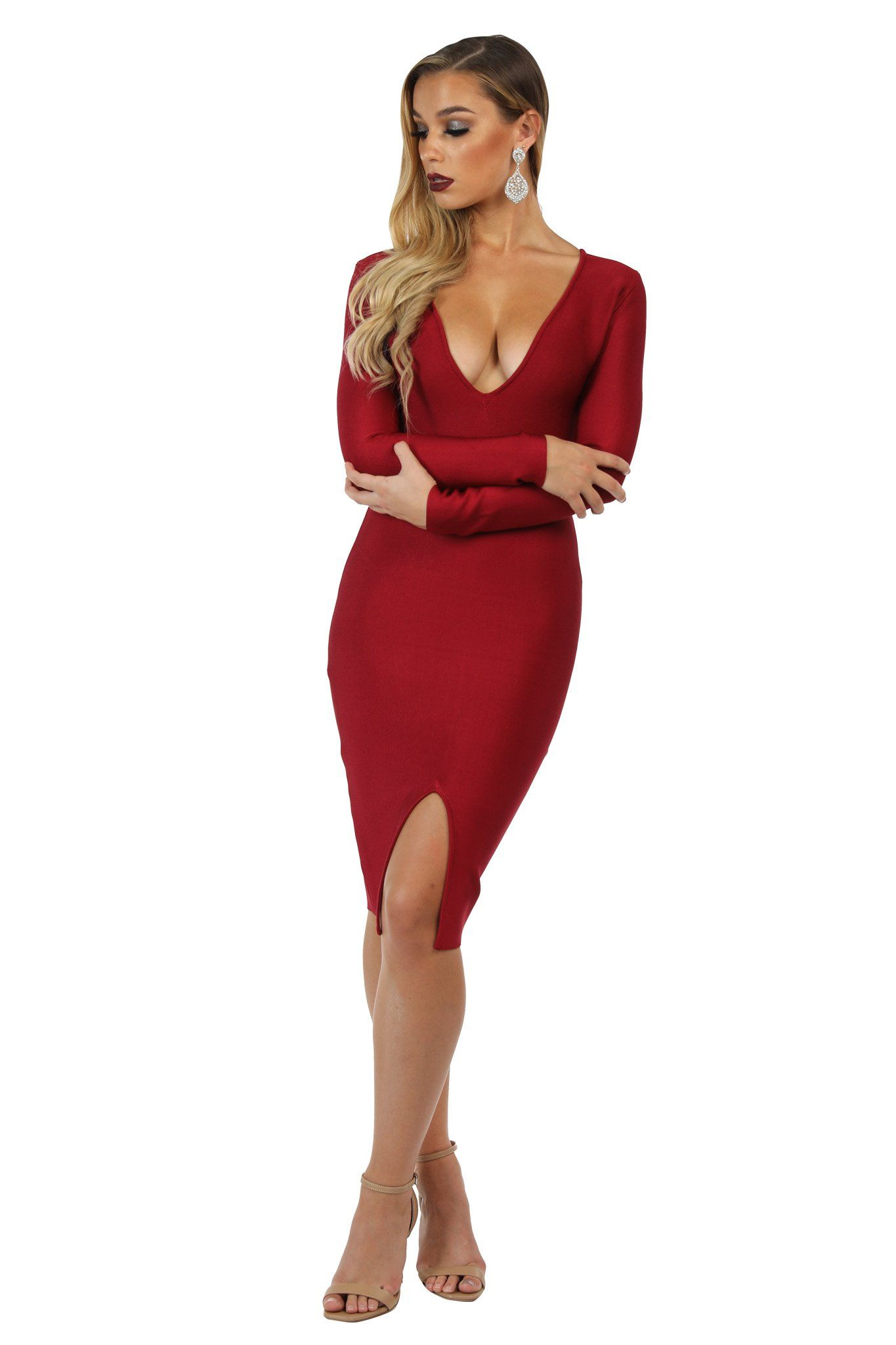 Wine red colored long sleeve knee length bandage dress with deep V neckline and V slit at the center front