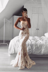 Fitted strapless wedding formal mermaid gown made from white sheer lace applique sewn over beige satin lining, sweetheart neckline, and train