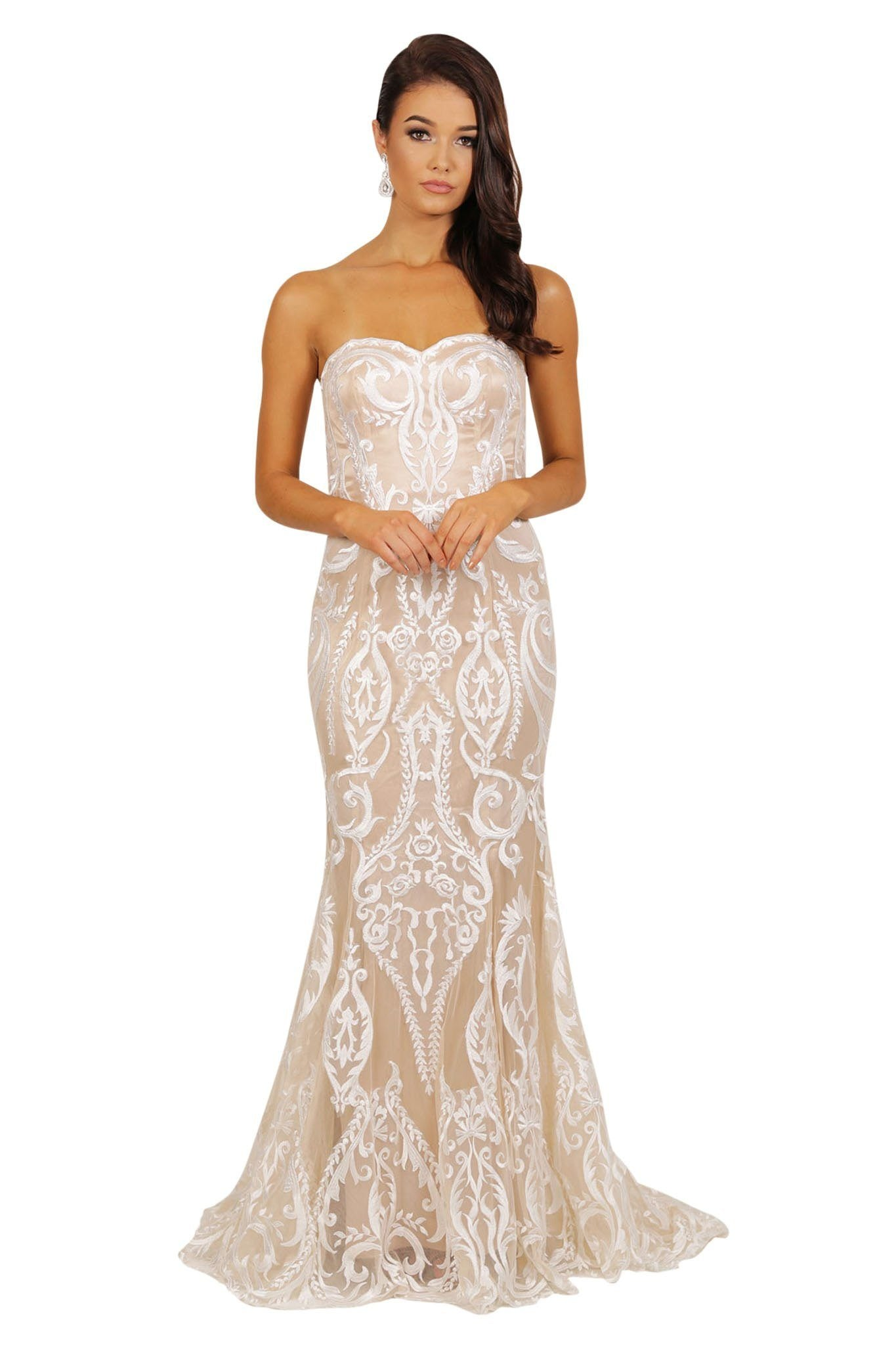 Fitted strapless wedding or formal gown made from white sheer lace applique sewn over beige satin lining, sweetheart neckline, and long train
