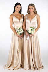 2 Bridemaids Wearing Champagne Coloured Satin Floor Length A Line Ball Gown with V Neckline