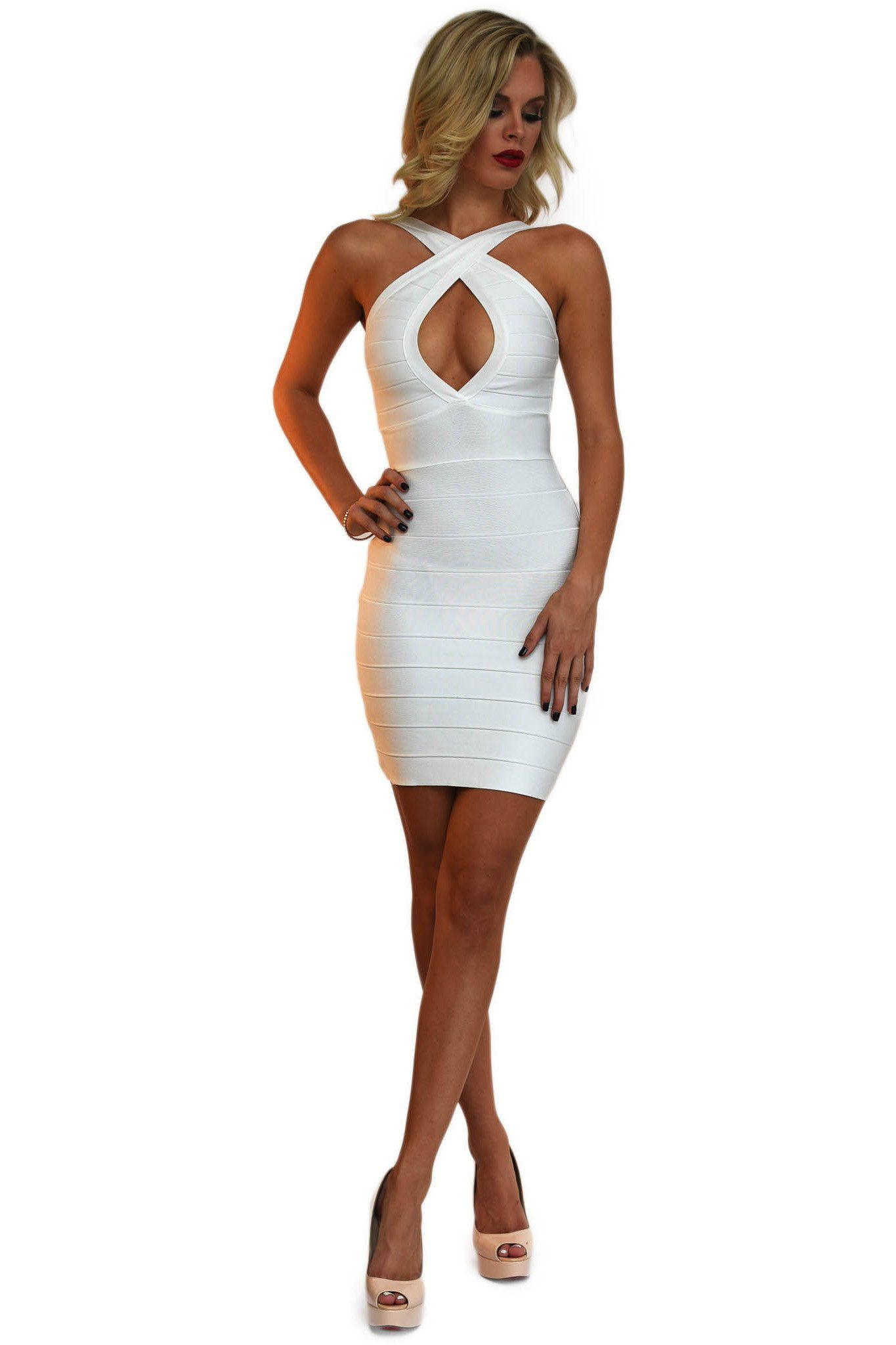 Front of white crisscross bodycon mini bandage dress featuring sexy peephole at the chest