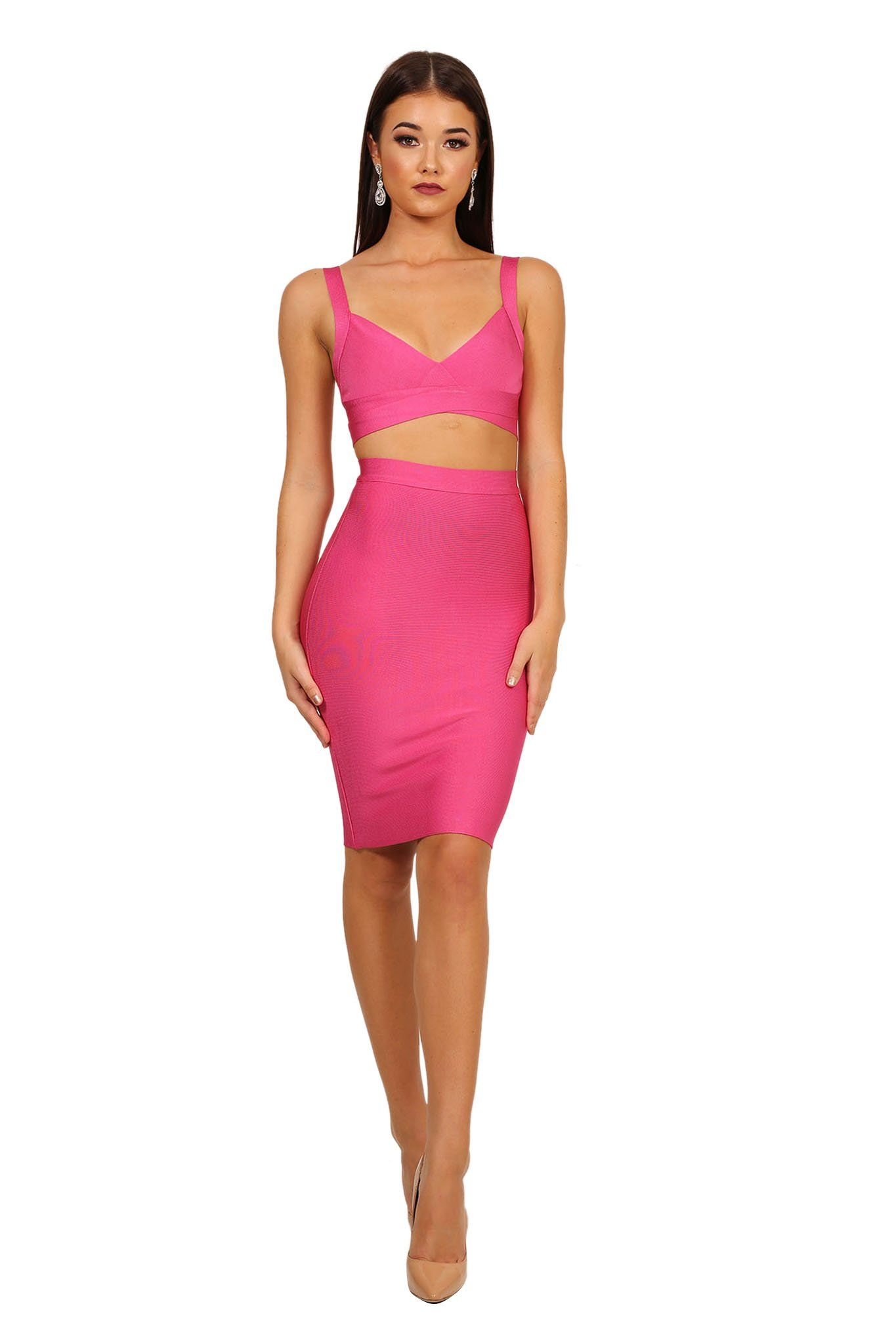 Hot Pink coloured two-piece bandage dress including bralette style top with cut outs and midi skirt