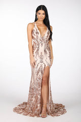 Rose Gold Full Length Evening Sequin Gown with Rose Gold Embroidered Pattern Sequins Over Light Pink Underlay, V neckline, Criss-cross Straps on Open Back, Thigh-high Side Slit, Fit and Flare Silhouette and Sweep Train