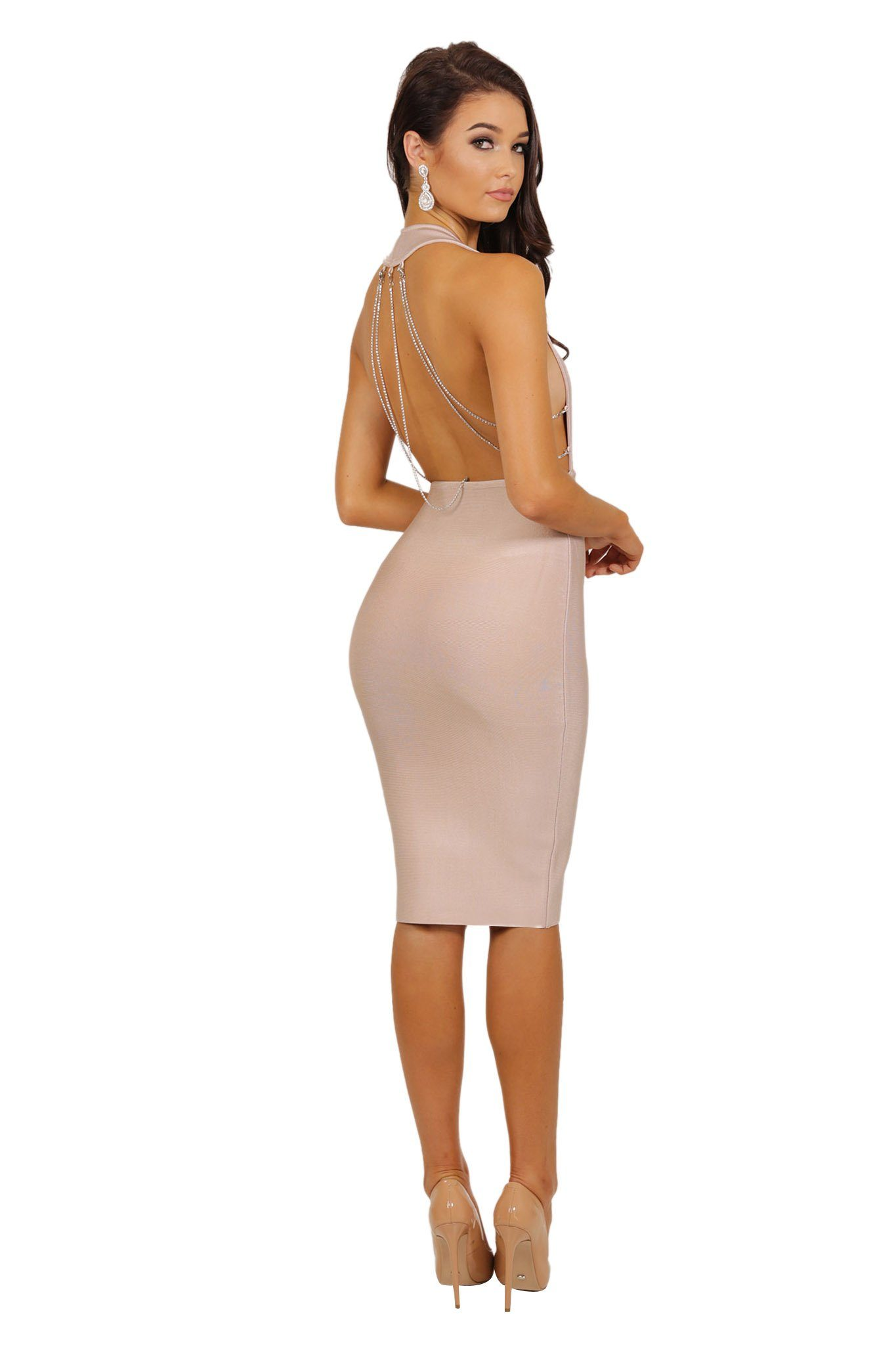 Nude colored knee length bandage dress sleeveless plunging neckline with dangling crystal chains at the back