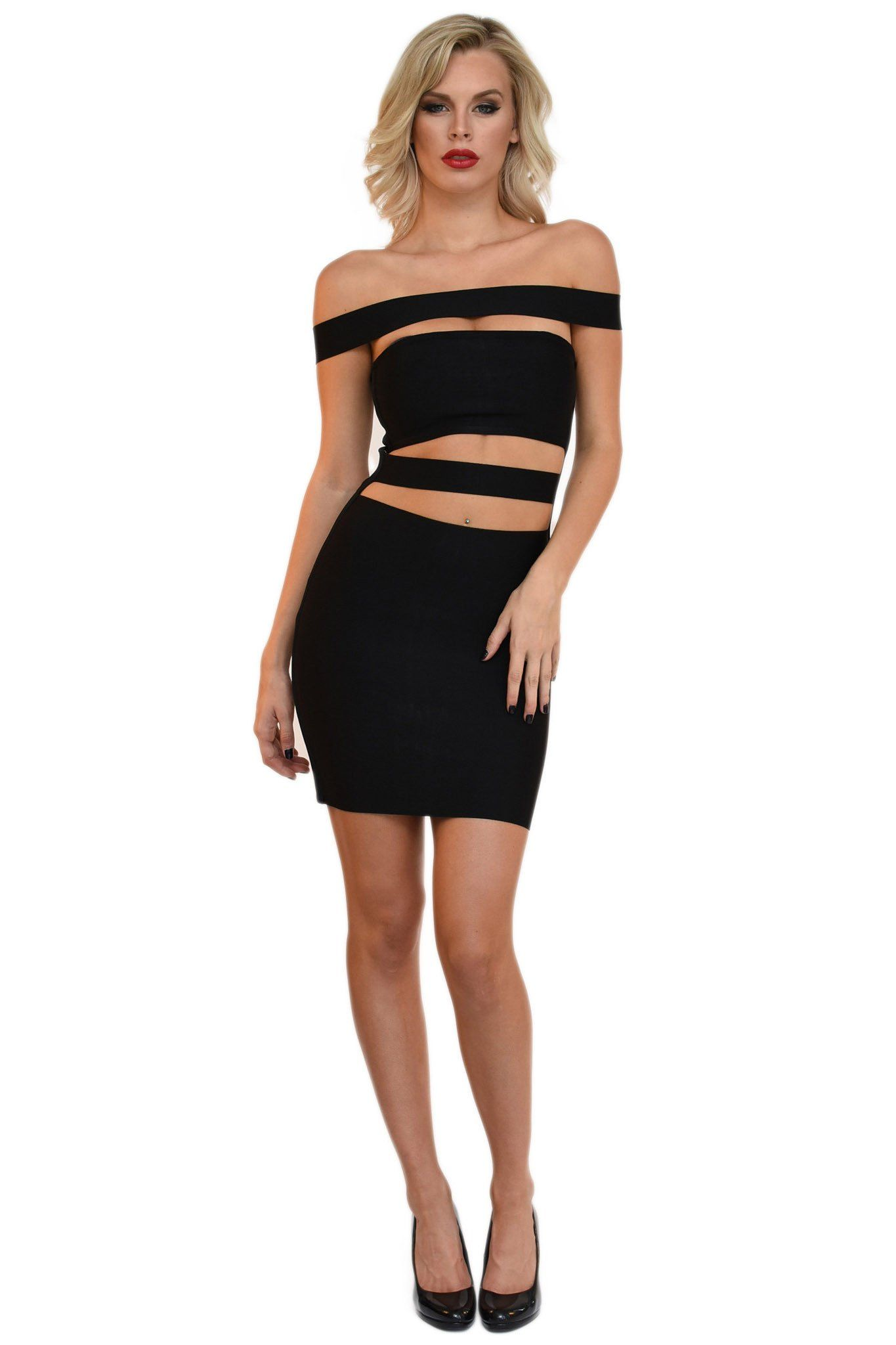Front of Kylie Jenner inspired black mini bandage dress with horizontal off-the-shoulder band and panel cutouts above the chest and around the waist