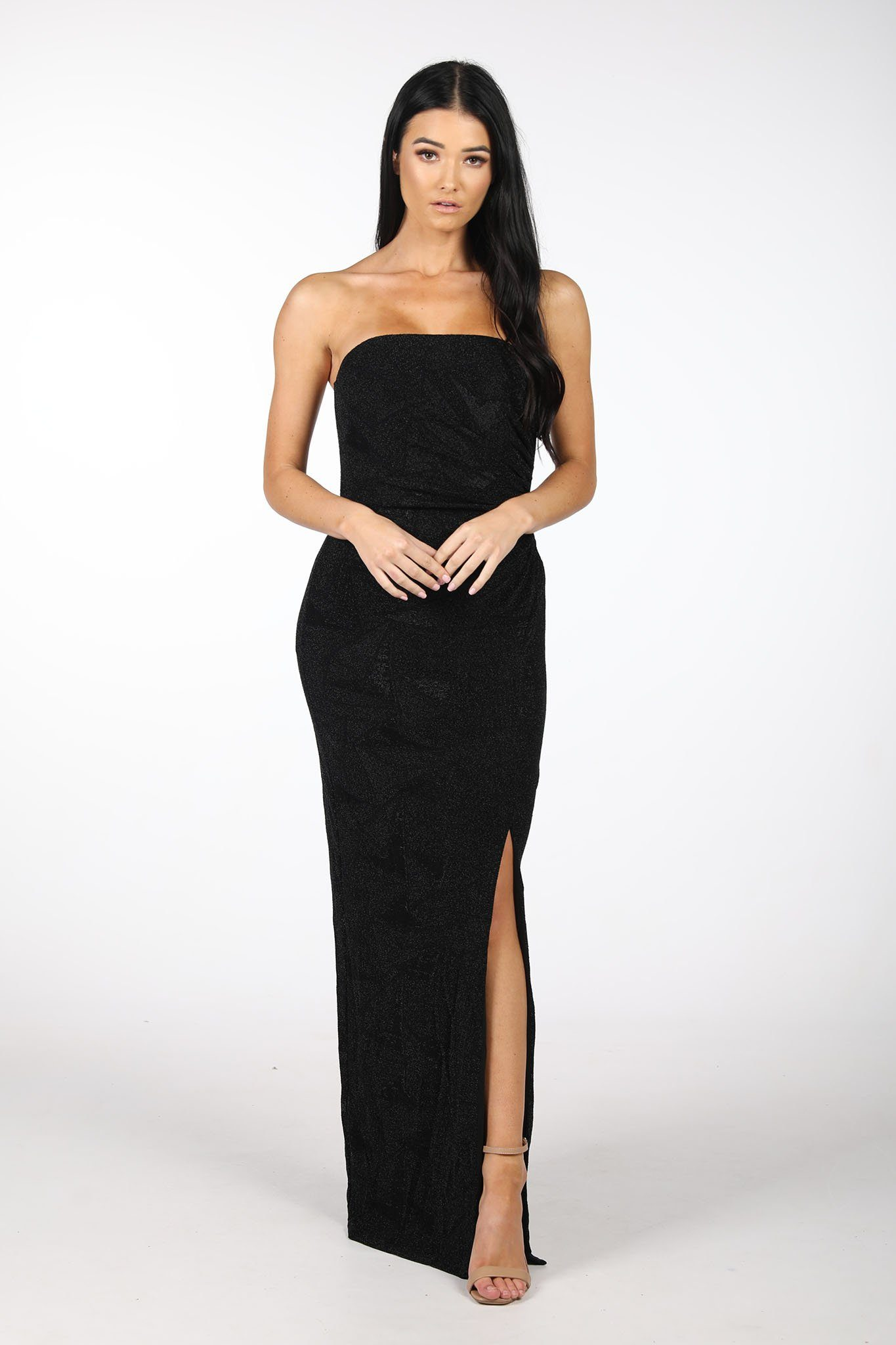 Black Maxi Dress Straight Strapless Neckline, Pleating Details, Column Styled Silhouette with a Side Split. Made with  Black Shimmer Thread Jersey Fabric in Geometric Patterns