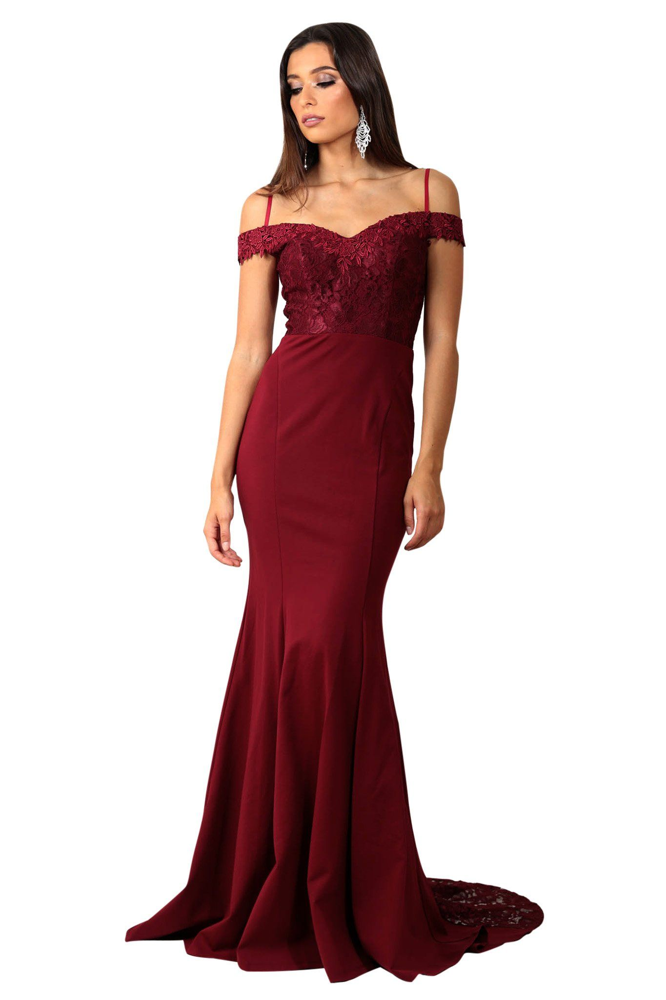 Off the shoulder evening long gown in wine red color with sweetheart neckline and lace trim details at the upper body and along the flowing trail