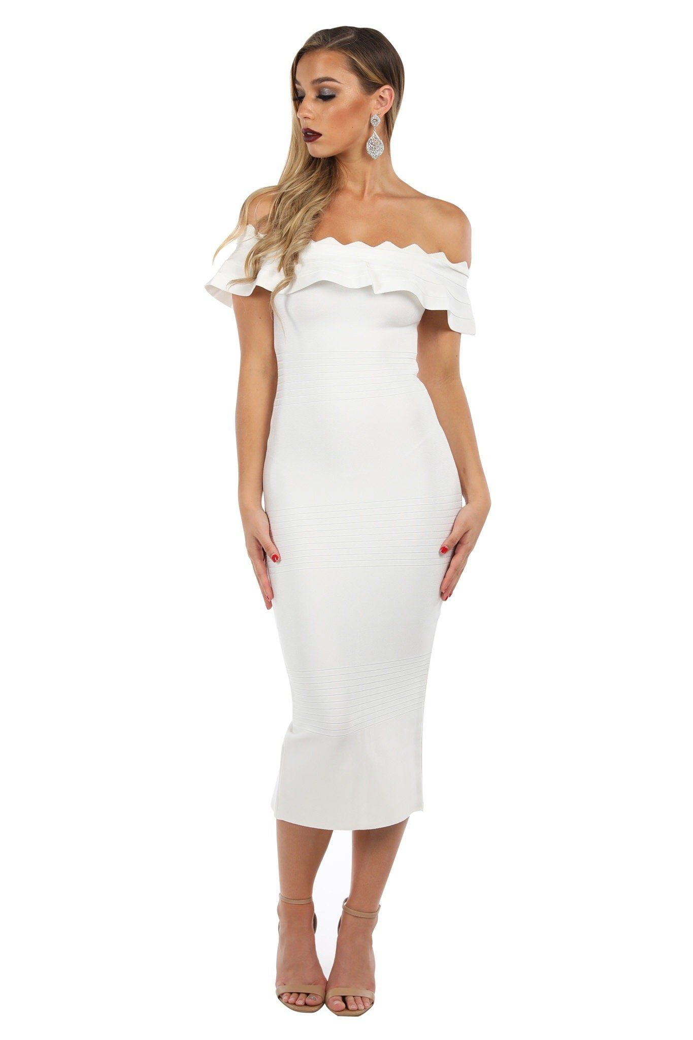 White below knee length bodycon bandage dress features off the shoulder ruffled neck, cap sleeves and back slit