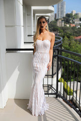 White embroidered sequin evening gown with nude illusion lining, strapless sweetheart neckline, fitted bodice and gently flared floor-length skirt