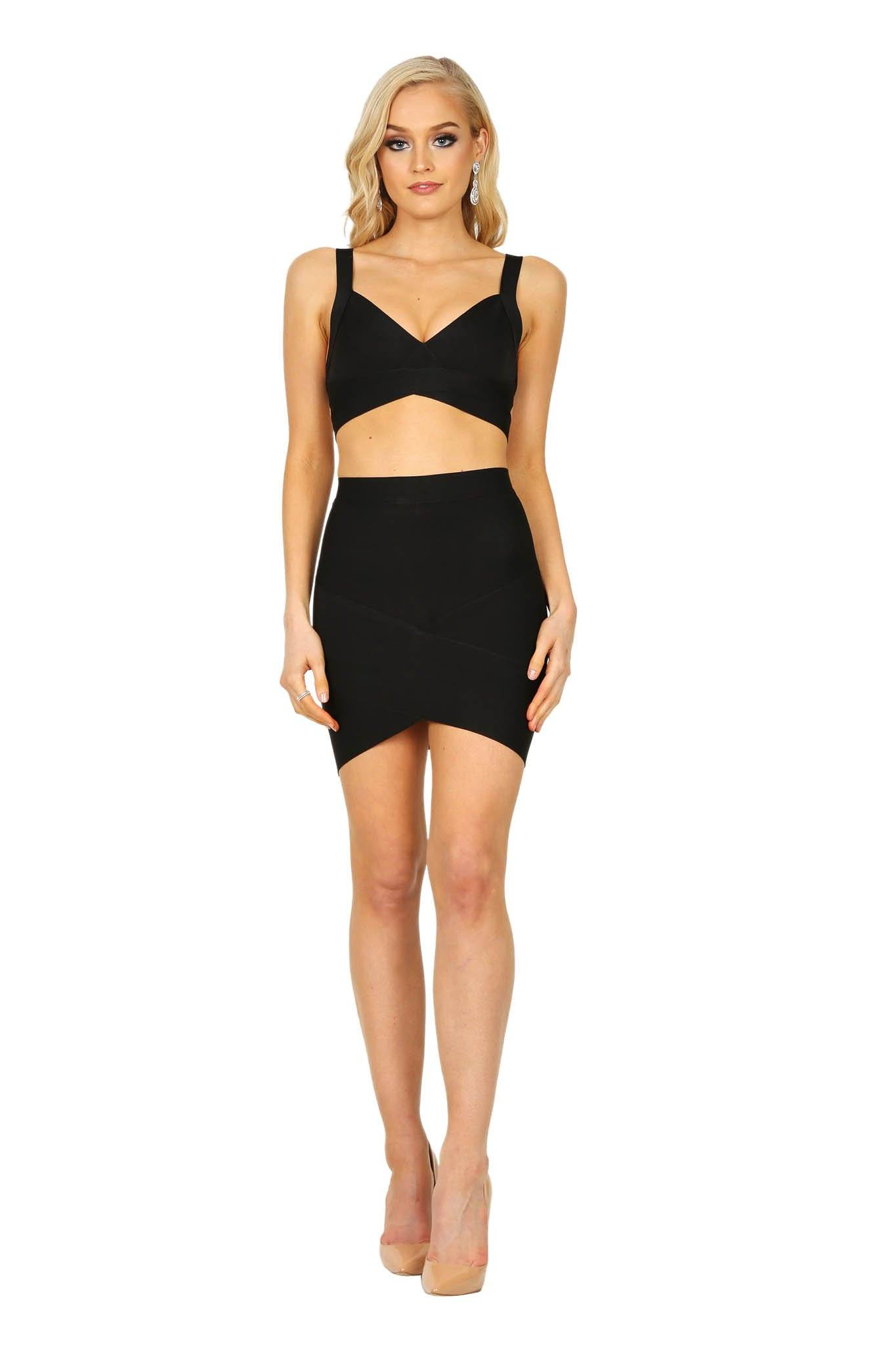 Black matching fitted bandage set including bralette style top and arched hem mini skirt