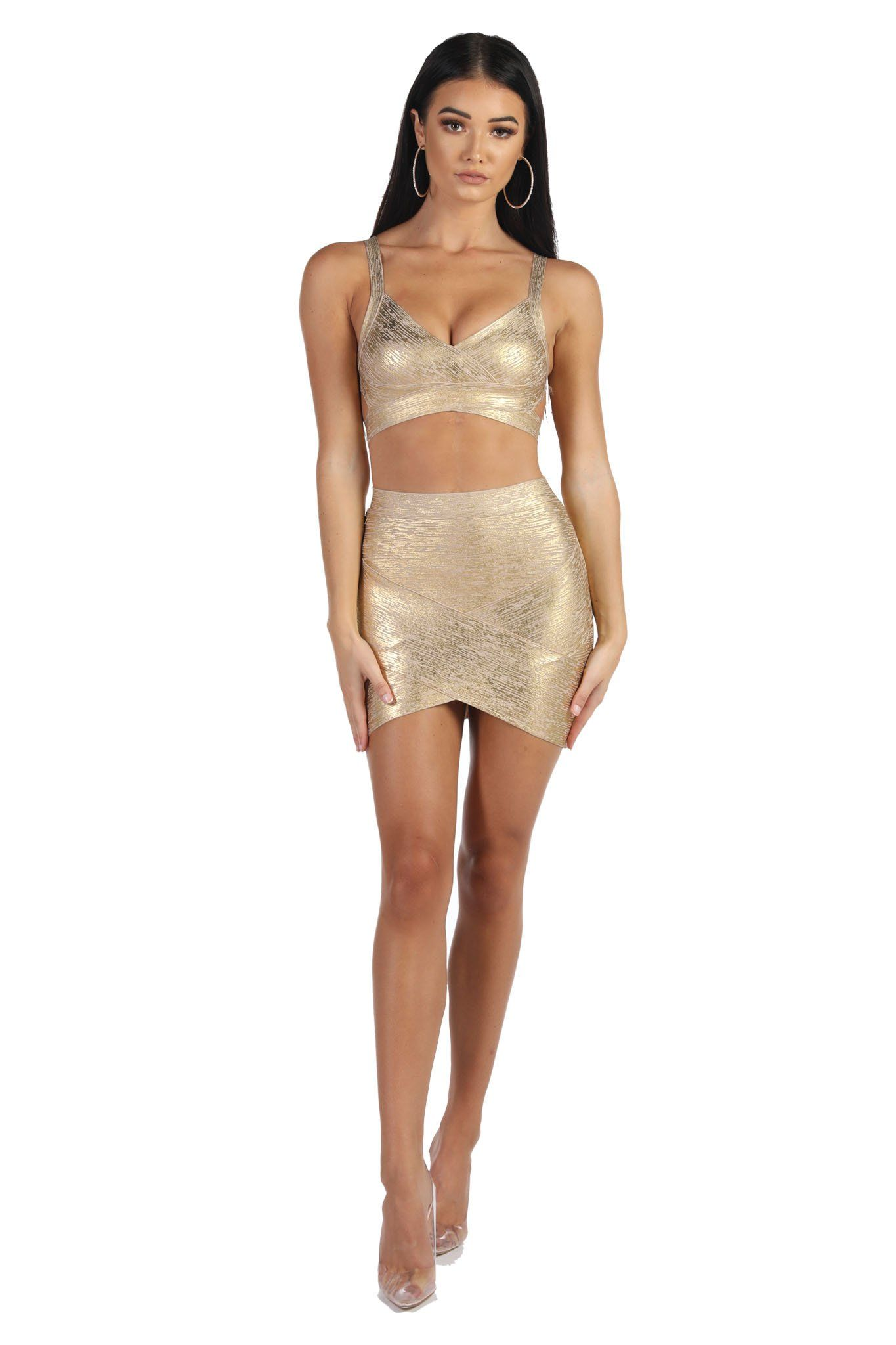 Gold foil bandage matching set including a bralette style top and an asymmetric hem mini skirt