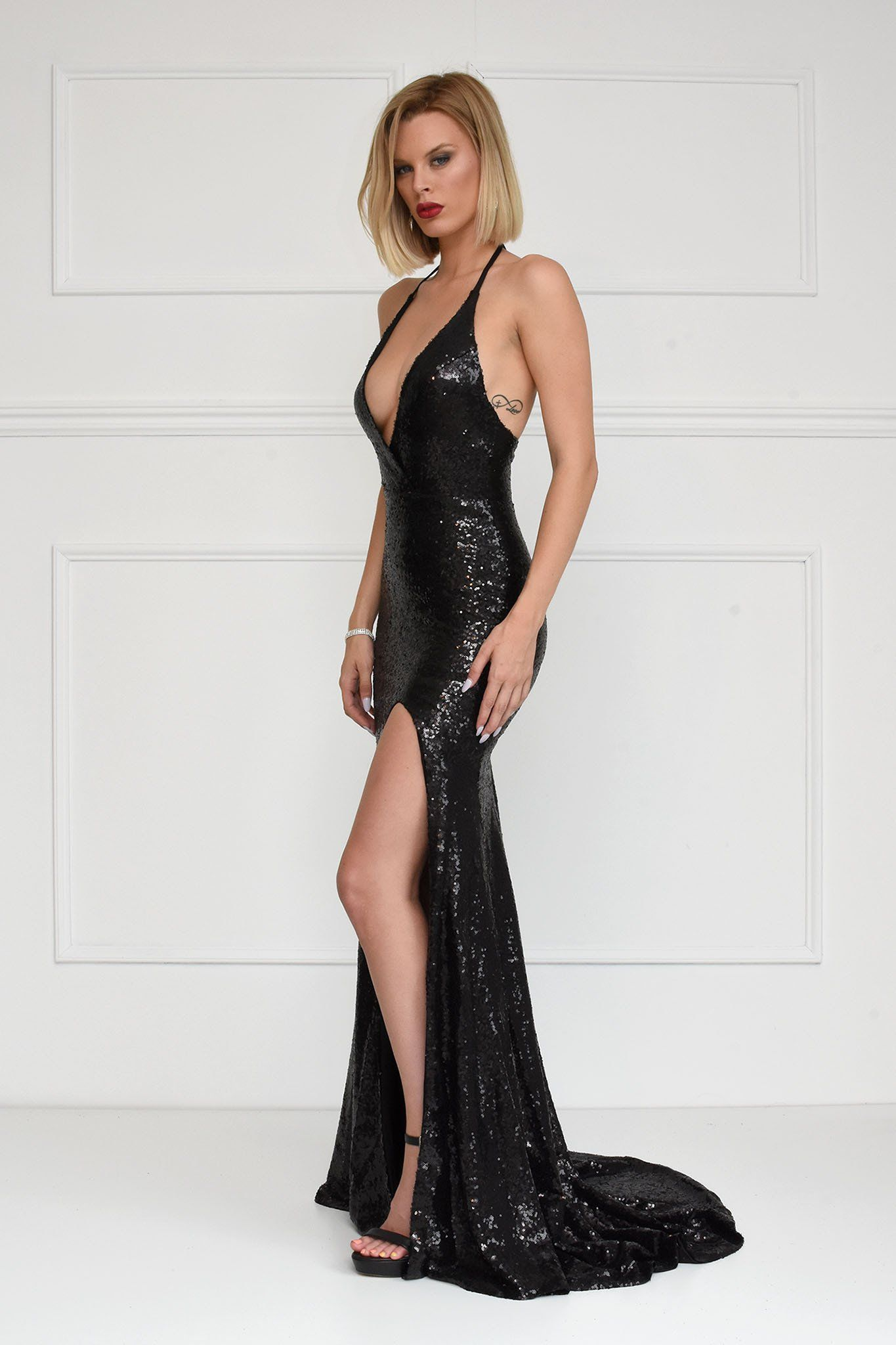 96768e3574e09 ... Black sleeveless sequin mermaid gown with deep V neckline