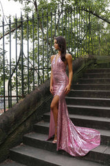 Bright pink sequin sleeveless evening long gown with deep V neckline, thigh-high slit, halter-neck strings, open back, and long train