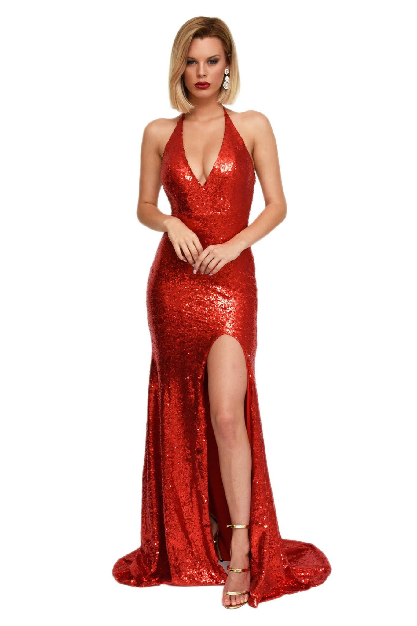 Front of red sparkly sequin floor length maxi sleeveless gown thin halter straps deep v neckline, high front leg split, long train