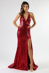 Full frontal shot of wine red colored sequin sleeveless long gown thin halter straps, deep v neckline, thigh high split, long train