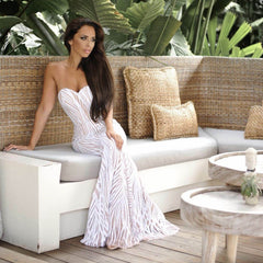 Fashion blogger Shiralee Coleman wearing EVITA sequin gown in white/beige from Noodz Boutique