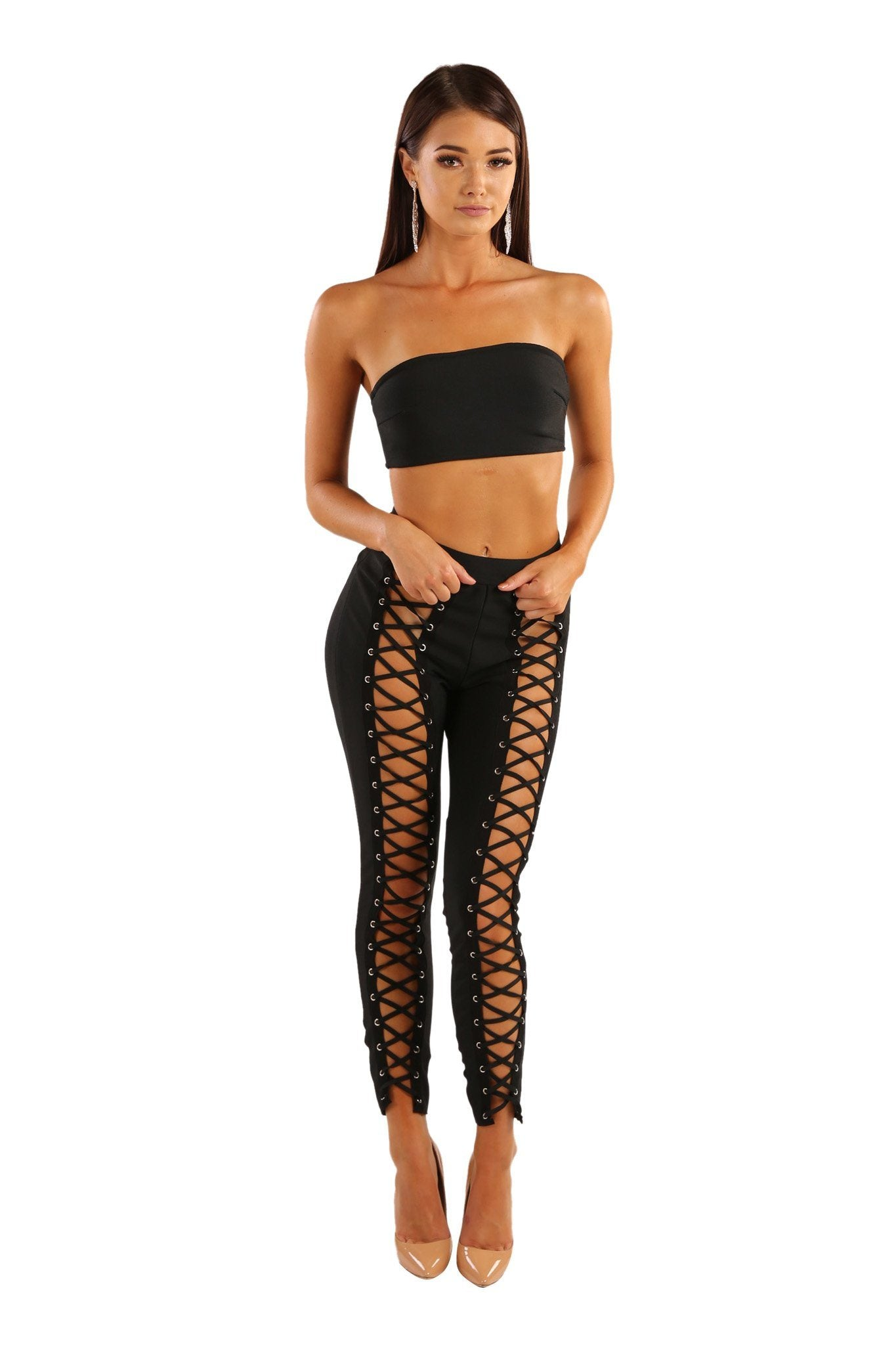 Black two piece bandage matching set including a bandeau bandage top and bandage leggings with lace-up design