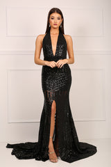 Front of black sequinned mermaid evening gown with halter v plunge neck and high centre front leg slit